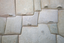 Interlocking Inca stonework in granite, in old town, now the Museo Arte Religioso, Cuzco, Peru, South America