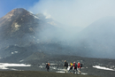 Hikers from the cablecar near the smoking summit of 3350m volcano Mount Etna during an active phase, Mount Etna, UNESCO World He