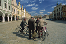 A group of elderly men talking in the 16th century town square in Telc, UNESCO World Heritage Site, South Moravia, Czech Republi