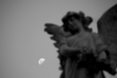 Angel sculpture with moon