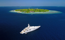island from above and yacht