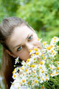 woman with a bunch of fresh chamomile