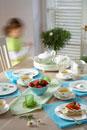 Tea and cake on laid table