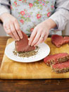 Seasoning tuna steaks with mixed pepper