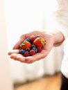 Hand Holding Mixture of Blueberries,Raspberries and Strawb