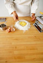 Making Pasta: Beating Eggs in Flour