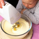 Little girl watching someone making ice cream