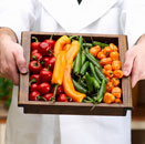 Man Holding a Tray of Mixed Peppers