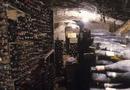 Bottles of aged wine in a wine cellar