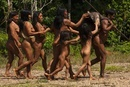 Huaorani Indian with a White-lipped peccary. The women and c