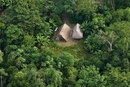Huaorani Houses seen from the air; simple structures built d