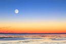 満月と海の夕景 宗谷岬から望む