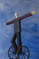 手を広げて車輪に乗る男性 クラフト