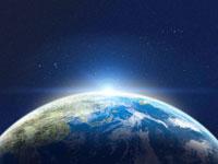 宇宙空間に浮かぶ地球の北半球と朝日