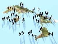 世界地図上で握手を交わす集団