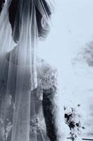 窓際のウェディングドレスを着た日本人女性  B/W