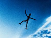 青空に飛ぶ人イメージ