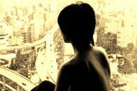 高速を見る後姿の裸の日本人の女性(セピア)
