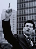 指さすビジネスマン B/W
