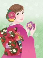 手まりを持つ和服の女性