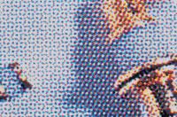 印刷された4原色のドットの顕微鏡写真