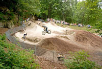 Teenagers jumping with dirt bikes