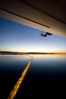 USA, California, San Francisco, flying over San Francisco Bay at night in the Airship Ventures Zepplin, Sam Mateo Bridge