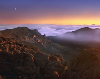 Sunrise and crescent moon overlooking Haleakala Crater
