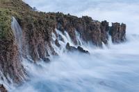 Water cascading down cliffs into ocean, Christmas Island Nat