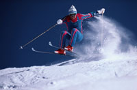 スキーでジャンプする人物