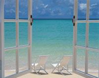 窓から見た海と2脚のデッキチェア  宮古島  沖縄県