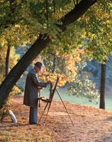 秋のブローニュの森で絵をかく老人