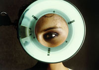 Young woman's eye magnified during eye examination 01809020959| 写真素材・ストックフォト・画像・イラスト素材|アマナイメージズ