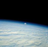 Shuttle photograph of the moon over the earth