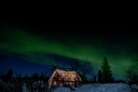 Aurora borealis over a tent
