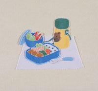 お弁当と水筒のきり絵