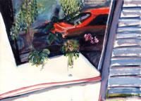 窓から見える赤いスポーツカー