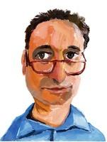メガネをかけた大きな目の中年男性