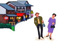 街道を観光する中年夫婦・秋