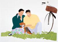 草むらで自転車で犬と散歩の若夫婦