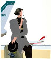 空港のロビーで旅立ちを待つ女性