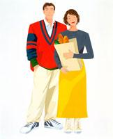 フランスパンのショッピング袋持つカップル