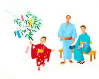 七夕に笹に短冊を飾る星の浴衣を着た家族