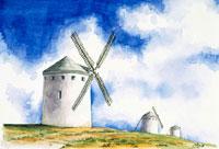 夏のスペインで入道雲を背に立つ風車の風景
