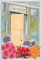 花屋の前のガーベラとチューリップとバラ