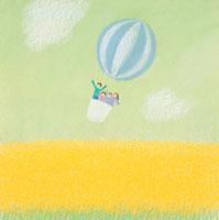 菜の花の上を気球に乗って飛んで行く家族