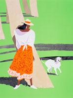 南の島のソテツ林で遊ぶ女性と犬
