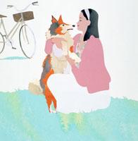 散歩の途中犬と遊ぶ女性