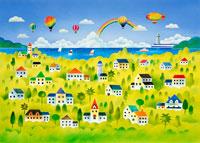 気球と虹のある緑の中の海辺の街