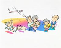 グライダー飛ばす子供と見上げる家族